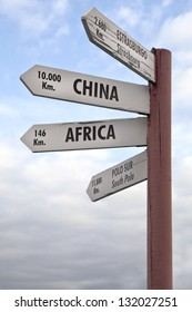 Crossroads Sign indicating the distance to China, Africa North Pole and Strasbourg.