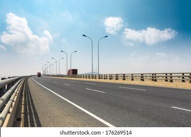 cross-sea bridge against a blue sky in shanghai
