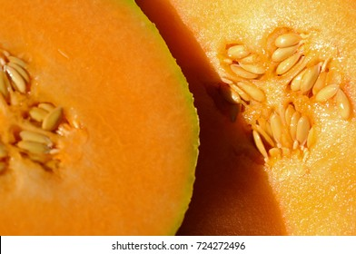 Cross-section of an orange-fleshed cantaloupe with seeds