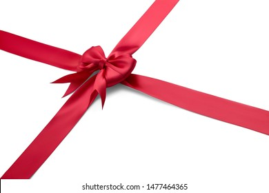 Cross-tied red gift silk ribbon with a big red beautiful shiny bow isolated on white background. Side view