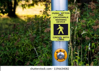 Crosswalk button mechanism on a steel post with a bush