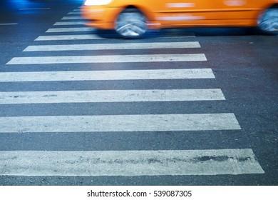 crosswalk and car