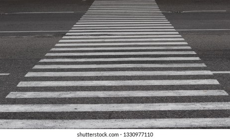 Crosswalk on the road for safety.