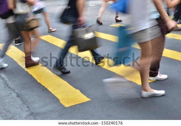 crosswalk and pedestrian at street in hong kong