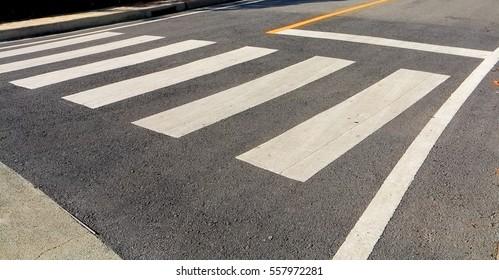 crosswalk street with park
