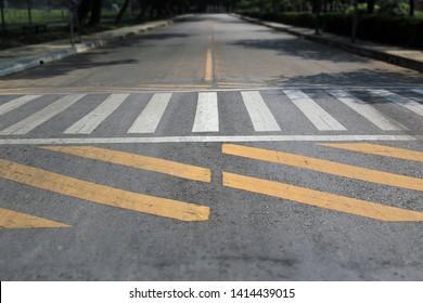 Crosswalk street in urban city area with traffic sign, Zebra crosswalk in town for safety people walking cross the road.