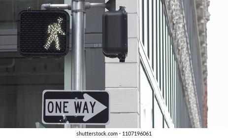 Crosswalk walk sign with lit up white man symbol