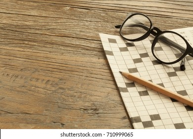 crossword at newspaper with coffee