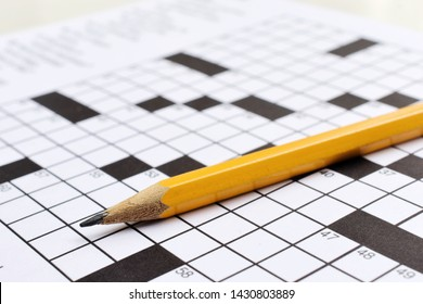 Crossword puzzle and a pencil on the table