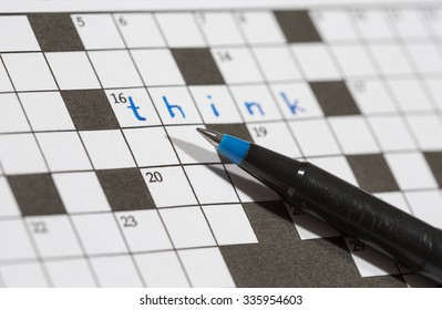 A crossword puzzle saying 'think'. An image of a pencil against an empty crossword puzzle. Crossword puzzles are excellent training for brains.