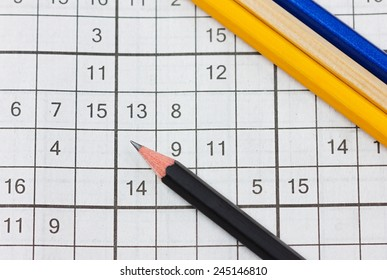 crossword sudoku and pencils, popular puzzle game with numbers