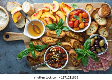 Crostini board with tomatoes, peaches and eggplant caponata dip