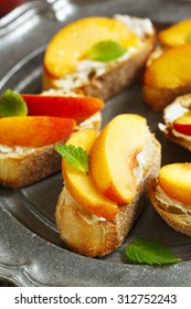 Crostini with cream cheese and fresh peaches.