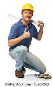 crouched handyman with spirit level isolated on white