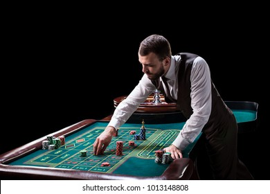Croupier behind gambling table in a casino.