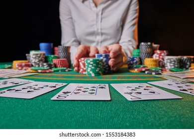 croupier raises bets with chips. casino, playing in a night club, gaming business. Winning and success, big money