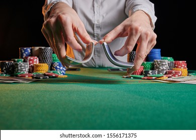 croupier shuffles and works with cards. Casino game, poker