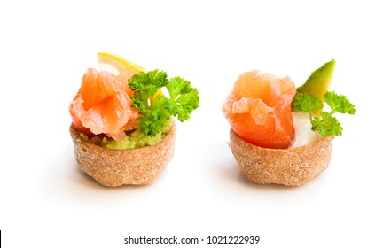 Croustades  crispy pastry cases filled with salted salmon and avocado isolated on white