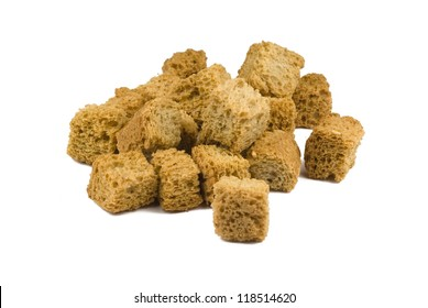 Croutons in a pile, isolated on a white background.