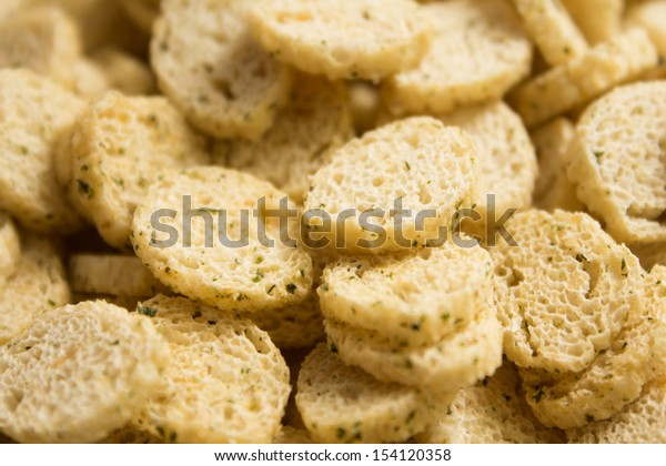 Croutons round. Background. Photo.