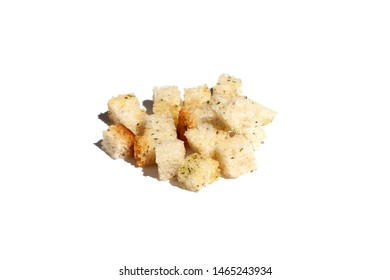 Croutons of white bread on a white background with strong shadow