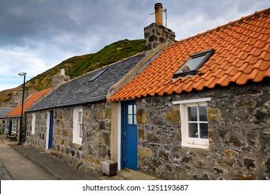 Crovie, Banff, Aberdeenshire, Scotland, UK - June 17, 2018: Row of stone houses in coastal fishing village of Crovie Banff Aberdeenshire Scotland UK