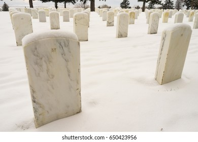 CROW AGENCY, MONTANA/UNITED STATES – DECEMBER, 10: Headstones in the fresh snow on 12/10/2016 in Little Big Horn Battlefield National Monument.