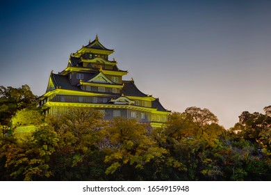 Crow Castle or Ujo Castle in Okayama City on the Asahi River in Japan With Traditional Maple Branches in The Frame. Horizontal Image Orientation