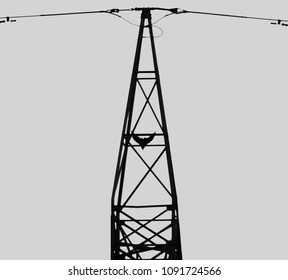 A crow flying down from a pylon