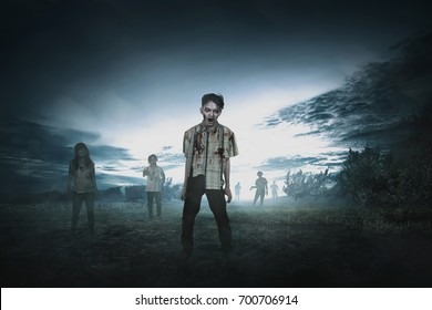 Crowd of aggressive asian zombies walking around on the spooky countryside