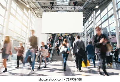 crowd of anonymous blurred business people at a trade fair