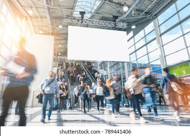 crowd of anonymous blurred people on a airport