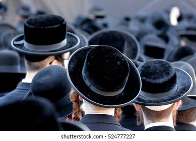Crowd of anonymous hasidim  men walking on a Jerusalem street