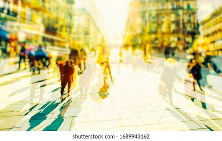 Crowd of anonymous people walking on busy city street, urban city life background