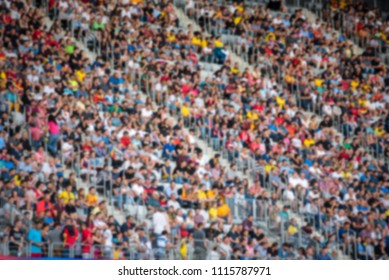 Crowd of blurred football spectators at the stadium