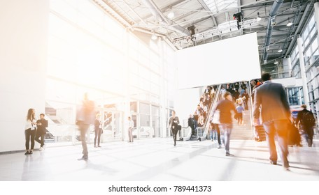 crowd of blurred people at a airport