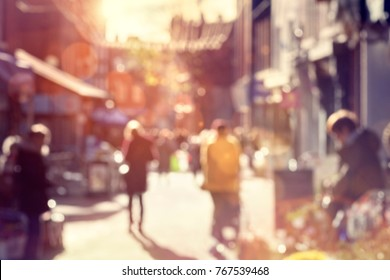 Crowd of blurred shoppers walking and shopping on a high street