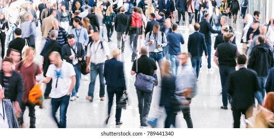crowd of business people at a trade show