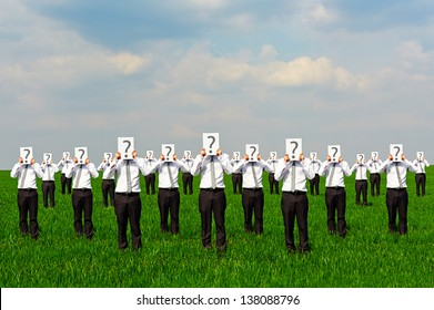 crowd of businessmen with question mark. concept photo