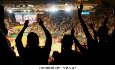 crowd cheering at basketball stadium