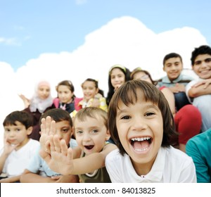 Crowd of children, sitting together happily
