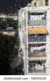Crowd of clear rain drops on the window glass surface