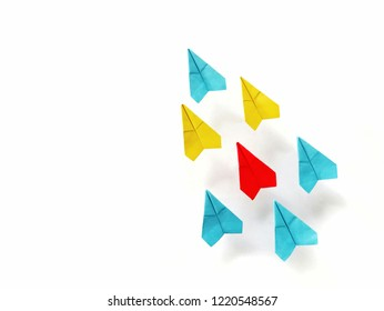 Crowd of colorful paper plane are flying on white background.