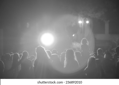 crowd at a concert in black and white light