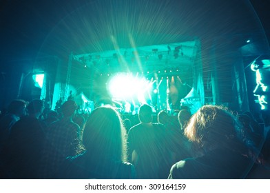 crowd at a concert in a blue light noise added