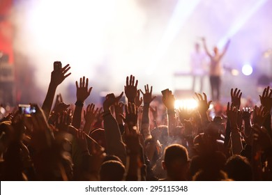 Crowd at concert and blurred stage lights - Shutterstock ID 295115348