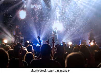 Crowd at concert - Cheering crowd in bright colorful stage lights