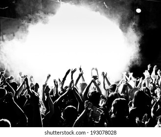 Crowd at a concert with hands up