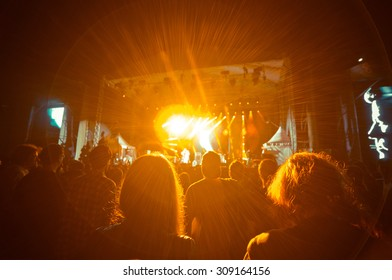 crowd at a concert in orange light noise added