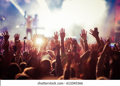 crowd at concert - summer music festival - Shutterstock ID 611045366